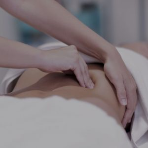 woman-having-abdomen-massage-by-professional-E5BSDN9-(1)